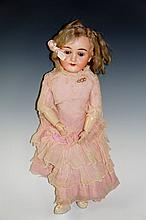 A Max Handwerk German doll with bisque head , flip back eyes, jointed compo
