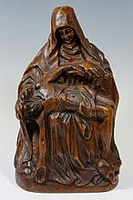 A 19th Century carved oak figure of Mary Magdalene and Christ, 30 cm high
