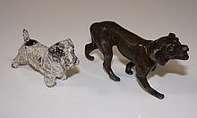 A bronzed white metal dog, 10 cm long; a cold painted white metal Terrier,