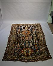 A Shirvan rug worked with five coloured geometric medallions on a cobalt bl