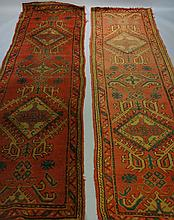 A near pair of Ushak runners worked with geometric medallions in green and