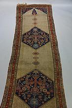 A Hamadan runner worked with two geometric medallions, figures, stylised fl