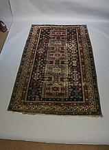 A Shirvan rug worked with five square filled medallions, the cobalt blue gr