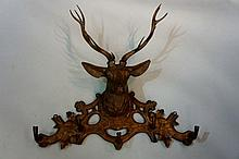 A good late 19th Century Black Forest coat stand the pierced back carved ac