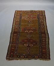A Hamadan rug worked with three geometric filled medallions on a sand groun