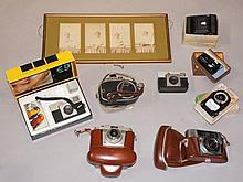 A quantity of vintage camera equipment including Kodak Instamatic 25 colour