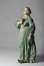 SMALL CARVED AND PAINTED FIGUREHEAD OF A YOUNG WOMAN HOLDING A ROSE, CIRCA 1840'S.
