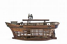 ELABORATE FOLK ART MAHOGANY, COPPER AND BRASS BIRDCAGE IN THE FORM OF A THREE-MASTED SHIP UNDER CONSTRUCTION.