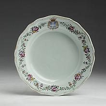CHINESE EXPORT PORCELAIN SOUP PLATE FOR THE FRENCH MARKET, BEARING THE ARMS OF VAUCOULEURS DE LANJAMET, CIRCA 1775.