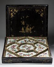 CHINESE EXPORT PORCELAIN FAMILLE ROSE SUPPER SET, IN THE ORIGINAL GILT-DECORATED BLACK LACQUER BOX, CIRCA 1860.