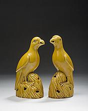 PAIR OF CHINESE EXPORT YELLOW-GLAZED POTTERY FIGURES OF PARROTS, EACH ON A PIERCED ROCKWORK BASE.