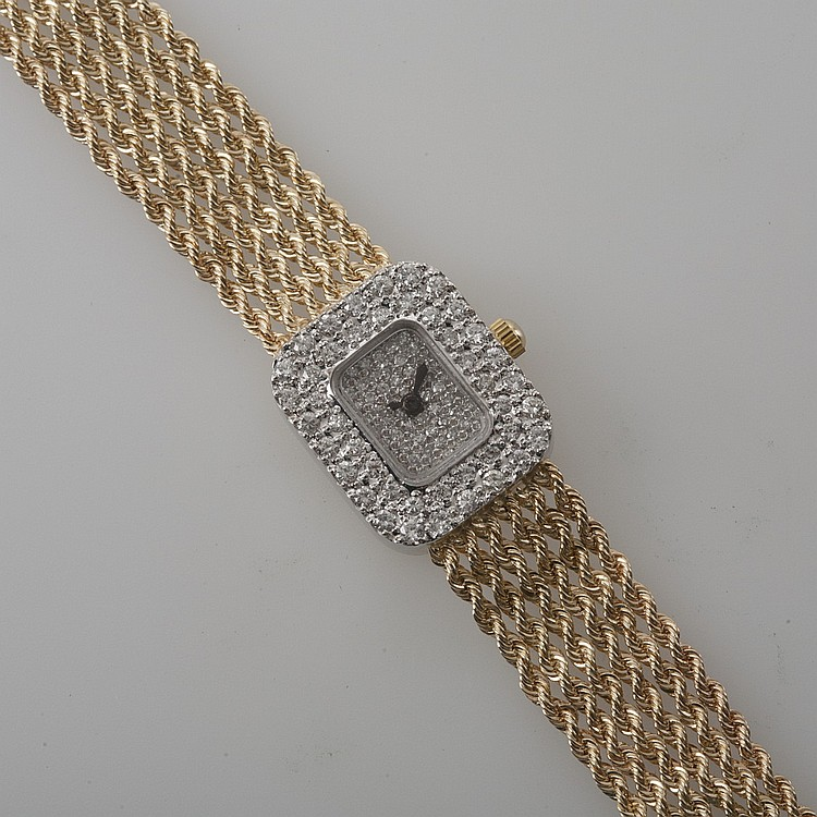 LADY'S SWISS 14K GOLD WATCH WITH DIAMONDS.
