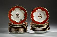 SET OF TEN CHAMBERLAINS WORCESTER AND ROYAL WORCESTER PORCELAIN ARMORIAL ORANGE-GROUND SOUP PLATES AND TWELVE PLATES, 1825-40 AND 1887-1909.
