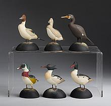 WALLACE LOVELL (MASSACHUSETTS, ACT. TWENTIETH CENTURY). SIX CARVED AND PAINTED MINIATURE DECOYS.