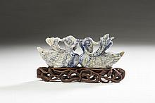 CHINESE CARVED SODALITE FIGURAL GROUP OF A PAIR OF CRESTED BILLING BIRDS, MOUNTED ON A PIERCE-CARVED HARDWOOD STAND.