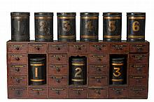 RED PAINTED AND DECORATED APOTHECARY LOW CUPBOARD AND A COLLECTION OF BLACK AND YELLOW PAINTED TIN CANNISTERS, MID-NINETEENTH CENTURY.