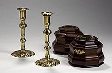 PAIR OF COLONIAL WILLIAMSBURG REPRODUCTION BRASS CANDLESTICKS AND A PAIR OF OCTAGONAL MAHOGANY TEA CADDIES, ALL IN GEORGE III STYLE, TWENTIETH CENTURY.