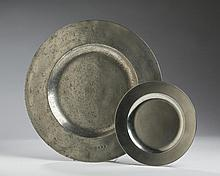 THOMAS CUTLOVE, LONDON PEWTER BROAD-RIM SHALLOW DISH FROM THE REIGN OF THE HOUSE OF STUART, LATE SEVENTEENTH CENTURY; AND A JOHN BENSON, LONDON PEWTER FLAT-RIM PLATE.