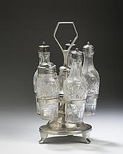 ISRAEL TRASK, BEVERLY, MASSACHUSETTS, PEWTER CRUET SET WITH PENTAGONAL TOP AND SHAPED FEET.