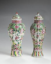 PAIR OF CHINESE EXPORT PORCELAIN FAMILLE ROSE GARNITURE VASES AND COVERS.
