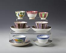 GROUP OF STAFFORDSHIRE 'PEAFOWL' AND RAINBOW SPATTERWARE TOY HANDLELESS CUPS AND SAUCERS, 1840-50.