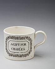 'A GIFT FOR CHARLES,' STAFFORDSHIRE PEARLWARE BLACK TRANSFER-PRINTED CHILDREN'S MUG, 1810-20.