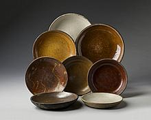 EIGHT GLAZED RED AND BUFF EARTHENWARE PLATES, NINETEENTH CENTURY.