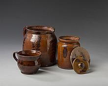 PENNSYLVANIA OR NEW ENGLAND GLAZED REDWARE BEAN POT AND A COVER, JAR AND A COVER, AND A PORRIDGE CUP, MID-NINETEENTH CENTURY.