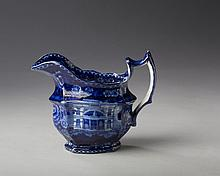 'BALTIMORE MASONIC HALL,' STAFFORDSHIRE DARK BLUE TRANSFER-PRINTED CREAM JUG, UNKNOWN MAKER, CIRCA 1820.