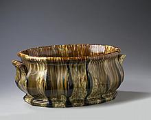 BENNINGTON FLINT ENAMEL 'SCALLOPED RIB' PATTERN FOOT BATH, 1848-58.