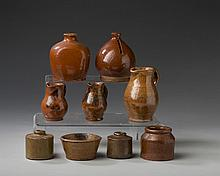 SEVEN GLAZED REDWARE MINIATURE AND DESK OBJECTS AND TWO STONEWARE INK POTS, MID-NINETEENTH TO EARLY TWENTIETH CENTURY.