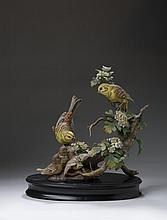 BOEHM PORCELAIN FIGURAL GROUP OF A PAIR OF YELLOWHAMMERS (BUNTINGS) WITH THREE CHICKS IN HAWTHORN, CIRCA 1973.