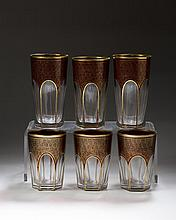 SET OF TWELVE BOHEMIAN RUBY FLASHED AND GILT-DECORATED TUMBLERS AND TWELVE GLASSES.
