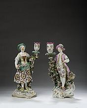 PAIR OF ASSOCIATED DERBY PORCELAIN CANDLESTICK FIGURES OF A GARDENER AND COMPANION, 1765-70.