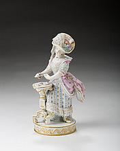 MEISSEN PORCELAIN FIGURE OF A LADY CARD PLAYER, 1850-1924.