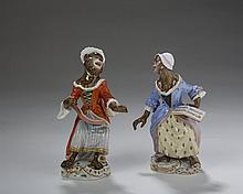 TWO MEISSEN PORCELAIN 'FEMALE VOCALIST' MONKEY BAND FIGURES, 1850-1924.