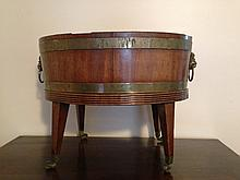 GEORGE III BRASS-BOUND MAHOGANY OVAL WINE COOLER.