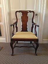 GEORGE II CARVED WALNUT ARMCHAIR.