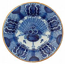 DUTCH DELFT BLUE AND WHITE 'PEACOCK' PATTERN PLATE, T' HART, SIGNED WITH THE INITIALS OF QUIRYNUS MESCH (OR MES), EARLY EIGHTEENTH CENTURY.