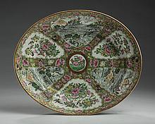 CHINESE EXPORT PORCELAIN 'ROSE MEDALLION WITH LANDSCAPE PANELS' OVAL DISH, LATE NINETEENTH CENTURY.
