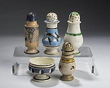 FOUR BRITISH EARTHENWARE CASTERS AND A FOOTED SALT, 1800-65.