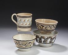THREE BRITISH CREAMWARE AND WHITE WARE MOCHAWARE SLIP-DECORATED EARTHWORM LONDON-SHAPE BOWLS AND A CAT'S EYES PORTER MUG, 1820-30.