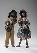 PAIR OF FOLK ART DOLLS WITH PAINTED WOOD HEADS.