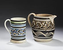 BRITISH CREAMWARE MOCHAWARE SLIP-DECORATED DOUBLE EARTHWORM QUART MUG WITH UNUSUAL ROULETTED BAND, AND A SLIP-DECORATED AND TRAILED JUG, CIRCA 1820.