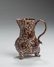 STAFFORDSHIRE CREAMWARE TORTOISESHELL-GLAZED 'BLOSSOMING BERRIED VINE' PATTERN MILK JUG, CIRCA 1765.