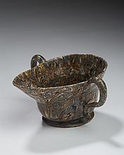 STAFFORDSHIRE SOLID AGATE SILVER-SHAPE TWO-HANDLED SAUCEBOAT, CIRCA 1750.
