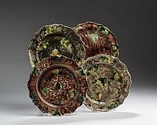 FOUR STAFFORDSHIRE CREAMWARE TORTOISESHELL-GLAZED PLATES, CIRCA 1765.