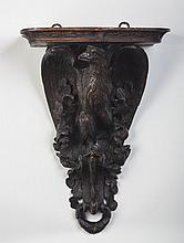 BLACK FOREST CARVED WALNUT CLOCK OR WALL BRACKET SHELF, THE STANDARD A DISPLAYED EAGLE, LATE NINETEENTH CENTURY.