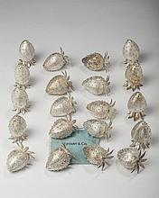 SET OF TWELVE MEXICAN SILVER STRAWBERRY-FORM PLACE CARD HOLDERS, FOUR SALT AND FOUR PEPPER CASTERS, JANNA THOMAS DE VELARDE, TAXCO, 1965-80, RETAILED BY TIFFANY & CO.