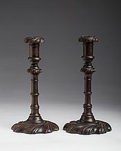 PAIR OF GEORGE III CARVED-WALNUT SWIRL-BASE CANDLESTICKS OF SILVER FORM.
